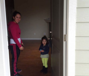 Alejandra and daughter in new home.