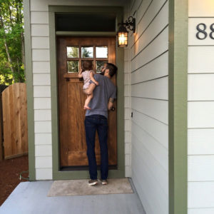 Dad and daughter getting ready to enter their new home.