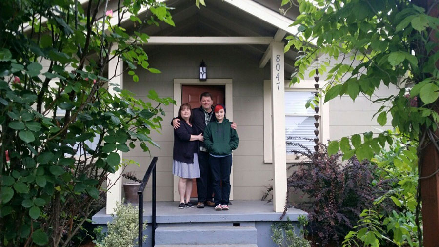 Canote Family in front of their new Portland home