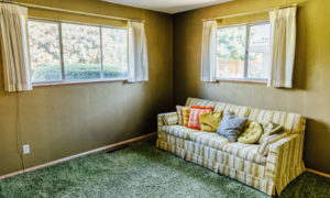 Side room with green carpet in home on NE 35th in Portland