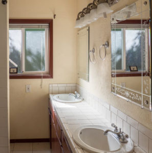 Tiled bathroom in home for sale by Realtor Shayna Denny