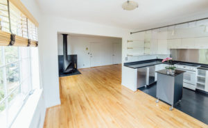 Open kitchen with oak flooring in home for sale by Shayna Denny