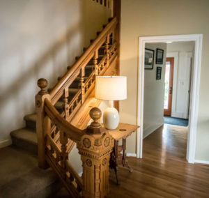 Carved bannister stairwell in home listed by Realtor Shayna Denny