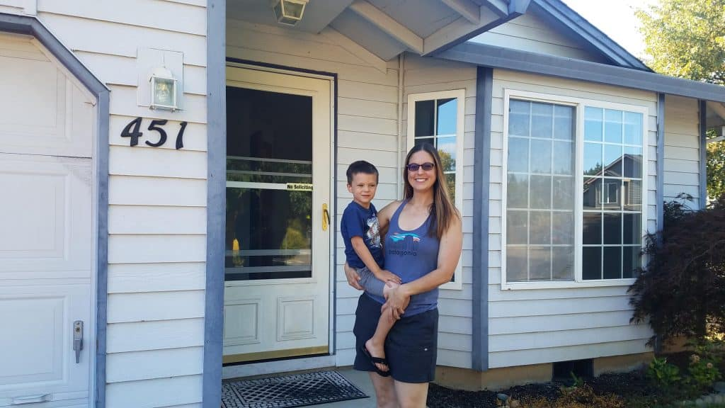 Shanley family in front of their new home.