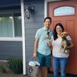 Cabral family in front of their new home