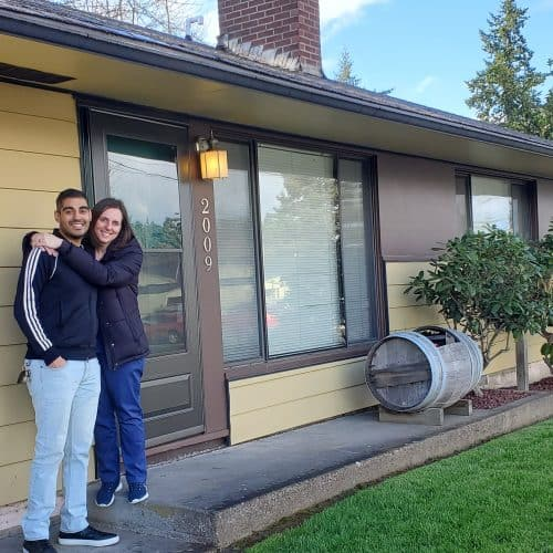Nick and Jen in front of their new home